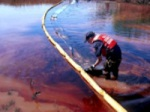 Enlarge: Cleaning up oil spills in Bound Brook, NJ.